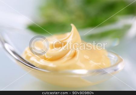Creamy sauce stock photo, Swirl of creamy sauce on a spoon by Digifoodstock