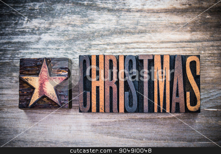 Vintage Christmas Letterpress  stock photo, The word Christmas and star written in vintage wooden letterpress letters. by Jason Enterline