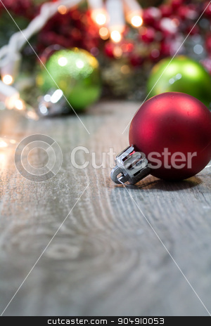 Christmas Ornaments on Wooden Floor stock photo, Christmas decorations and ornaments on a wooden background. by Jason Enterline
