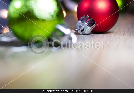 Shiny Christmas Ornaments Background stock photo, Colorful Christmas ornaments on a wooden background. by Jason Enterline