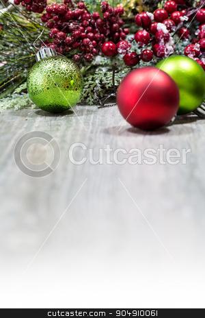 Christmas Ornaments Background stock photo, A wooden background with Christmas ornaments and decorations by Jason Enterline