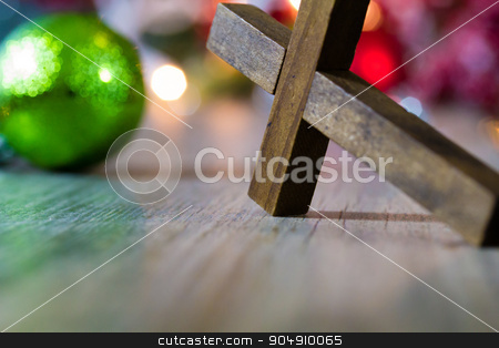 Colorful Christmas Ornaments and Christian Cross stock photo, Colorful Christmas ornaments and lights on a wooden background with a christian cross. by Jason Enterline