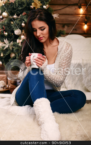 Woman holding a red cup of hot drink. Drink hot tea or coffee in the morning cool. Traditional autumn or winter warming drin stock photo, Woman holding a red cup of hot drink. Drink hot tea or coffee in the morning cool.   by mykhalets