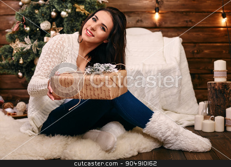 Happy young woman giving christmas present box stock photo, Happy young  woman giving christmas present box by mykhalets