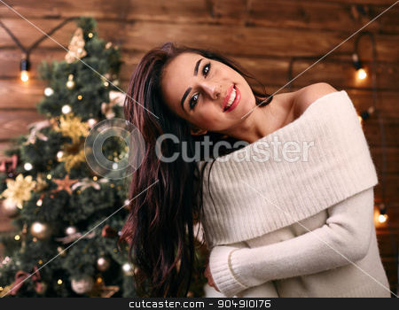 Christmas and people concept - happy young girl  near christmas tree tree having fun   stock photo, Christmas and people concept  happy young girl  near christmas tree tree having fun   by mykhalets