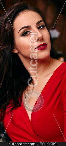 people, holidays and fashion concept - beautiful sexy woman in red dress stock photo, Young, beautiful and passionate woman i ed dress over  by mykhalets