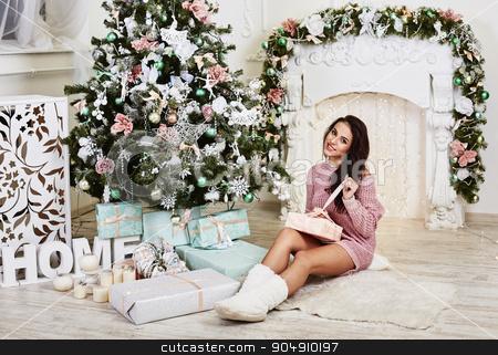 Young beauty smiling santa woman near the Christmas tree. Fashionable luxury girl celebrating New Year. Beautiful luxury trendy brunette stock photo, Young beauty smiling santa woman near the Christmas tree. Fashionable luxury girl  celebrating New Year. Beautiful luxury trendy brunette by mykhalets