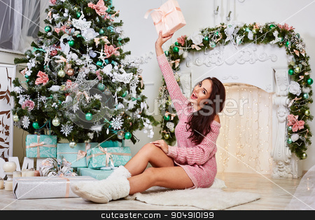 Young beauty smiling santa woman near the Christmas tree. Fashionable  luxury girl celebrating New Year. Beautiful luxury trendy brunette stock photo, Young beauty smiling santa woman near the Christmas tree. Fashionable luxury girl celebrating New Year. Beautiful luxury trendy brunette by mykhalets