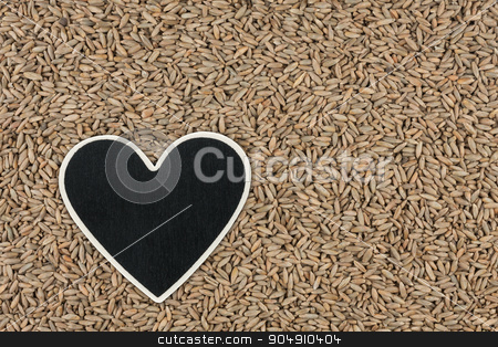 Heart pointer, the price tag lies on grains rye stock photo, Heart pointer, the price tag lies on grains rye,  with space for your text by alekleks