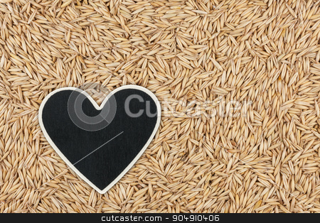 Heart pointer, the price tag lies on grains oats stock photo, Heart pointer, the price tag lies on grains oats,  with space for your text by alekleks