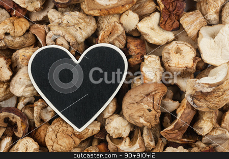 Heart pointer, the price tag lies on dried mushroom stock photo, Heart pointer, the price tag lies on dried mushroom,  with space for your text by alekleks