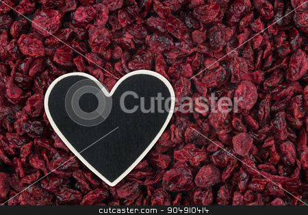 Heart pointer, the price tag lies on dried cranberry stock photo, Heart pointer, the price tag lies on dried cranberry,  with space for your text by alekleks