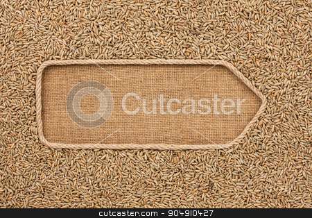 Pointer made from rope with grains rye lying on sackcloth stock photo, Pointer made from rope with grains rye lying on sackcloth, with space for your text by alekleks