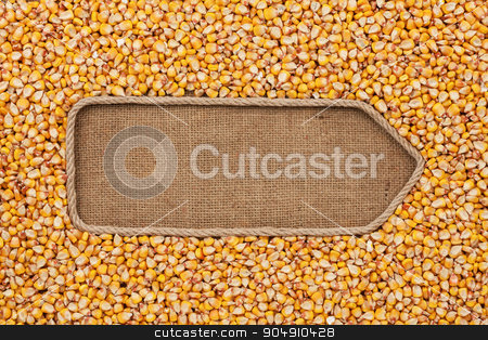 Pointer made from rope with grains corn  lying on sackcloth stock photo, Pointer made from rope with grains corn  lying on sackcloth, with space for your text by alekleks