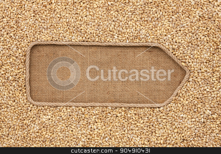 Pointer made from rope with grains pearl barley lying on sackcloth stock photo, Pointer made from rope with grains pearl barley lying on sackcloth, with space for your text by alekleks