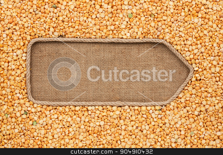 Pointer made from rope with grain peas  lying on sackcloth stock photo, Pointer made from rope with grain peas  lying on sackcloth, with space for your text by alekleks