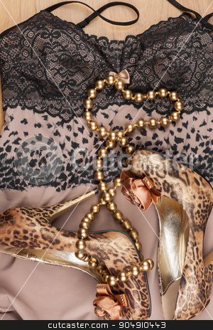 Gold beads lie on shoes and underwear stock photo, Gold beads lie on shoes and underwear, fashionable background by alekleks