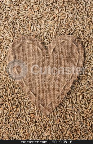 Frame in the shape of heart made of burlap with rye stock photo, Frame in the shape of heart made of burlap with rye, with space for your text by alekleks