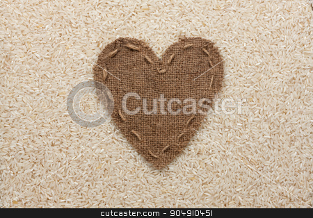 Frame in the shape of heart made of burlap with rice stock photo, Frame in the shape of heart made of burlap with rice, with space for your text by alekleks