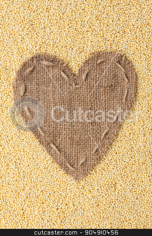 Frame in the shape of heart made of burlap with millet stock photo, Frame in the shape of heart made of burlap with millet, with space for your text by alekleks