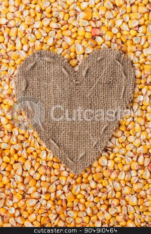Frame in the shape of heart made of burlap with corn stock photo, Frame in the shape of heart made of burlap with corn, with space for your text by alekleks