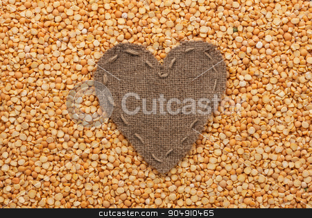 Frame in the shape of heart made of burlap with dry peas stock photo, Frame in the shape of heart made of burlap with dry peas, with space for your text by alekleks