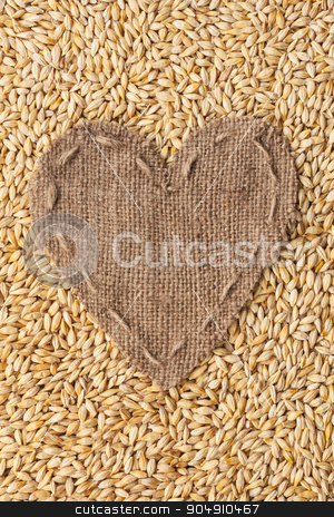 Frame in the shape of heart made of burlap with barley stock photo, Frame in the shape of heart made of burlap with barley, with space for your text by alekleks