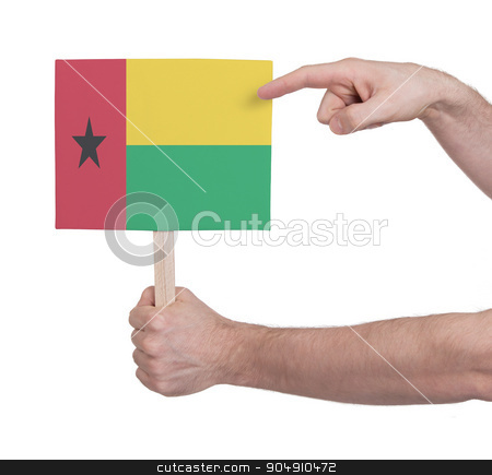 Hand holding small card - Flag of Guinea Bissau stock photo, Hand holding small card, isolated on white - Flag of Guinea Bissau by michaklootwijk