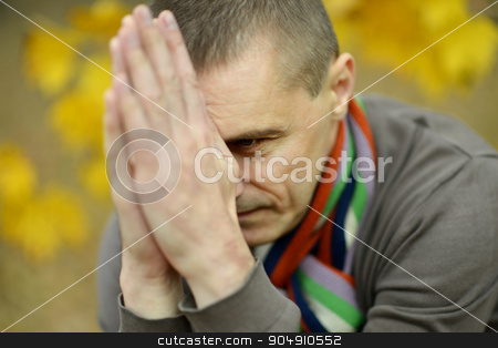 Sad man out for a walk  stock photo, Sad man out for a walk in the early autumn by Ruslan Huzau