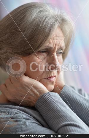 Portrait of thinking elderly woman stock photo, Portrait of thinking elderly woman, close up by Ruslan Huzau