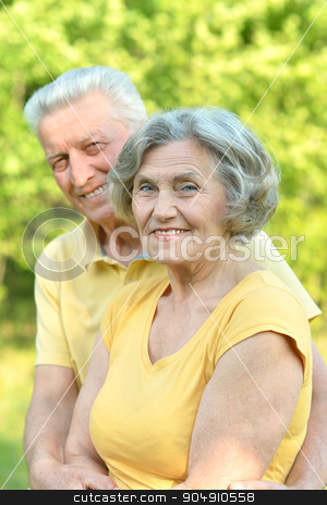 Mature couple in summer day stock photo, Happy Mature couple in the park in summer day by Ruslan Huzau