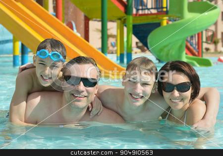 Happy family having  in pool stock photo, Happy family having fun in a pool by Ruslan Huzau