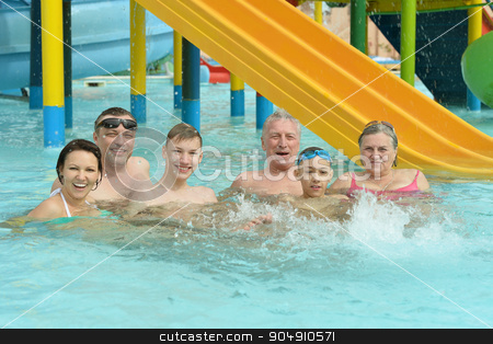 Family relax in  pool stock photo, Portrait of a happy family relax in the pool by Ruslan Huzau