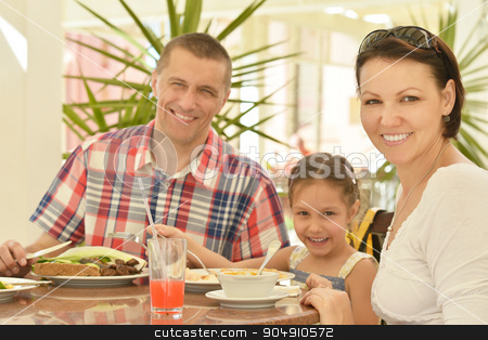 Happy family at breakfast stock photo, Happy family at breakfast on the table by Ruslan Huzau