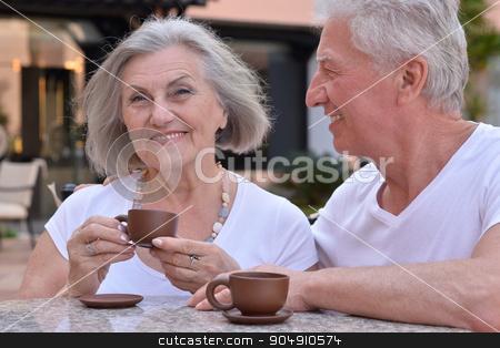 senior couple with coffee stock photo, Nice senior couple with coffee on vacation by Ruslan Huzau