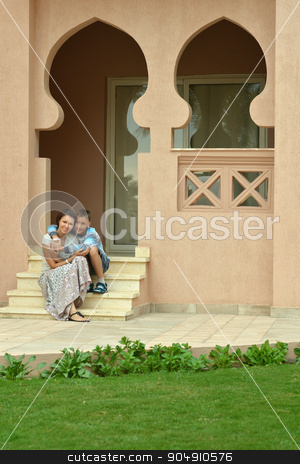Happy mother and son stock photo, Happy mother and son on vacation resort near hote by Ruslan Huzau