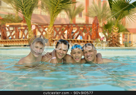 Happy family in  pool stock photo, Portrait of a happy family relax in the pool by Ruslan Huzau