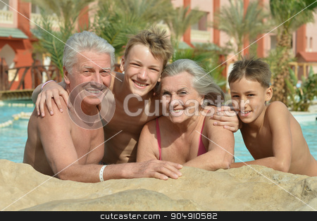 Happy Elderly couple with grandsons stock photo, Happy Elderly couple resting at pool together with grandsons by Ruslan Huzau