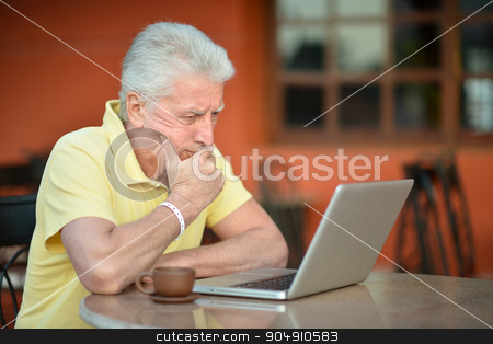 senior man with laptop stock photo, senior man sitting with laptop and coffee in hotel by Ruslan Huzau
