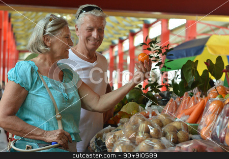 beautiful elderly couple in  market stock photo, Portrait of beautiful elderly couple in  market by Ruslan Huzau