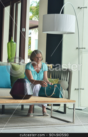 senior woman resting in hotel hall stock photo, Nice senior woman resting in hotel hall by Ruslan Huzau