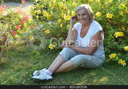 elderly woman   in tropical garden stock photo, Happy elderly woman   in tropical garden outdoor by Ruslan Huzau
