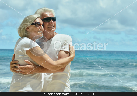 Senior couple at sea stock photo, Happy cute senior couple in sunglasses at sea by Ruslan Huzau