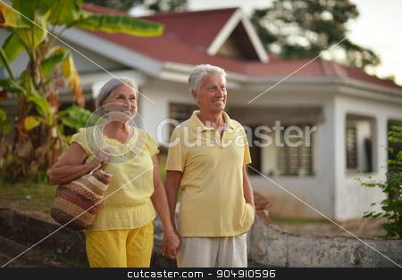 Senior couple near hotel resort stock photo, Portrait of a senior couple relaxing near  hotel resort by Ruslan Huzau
