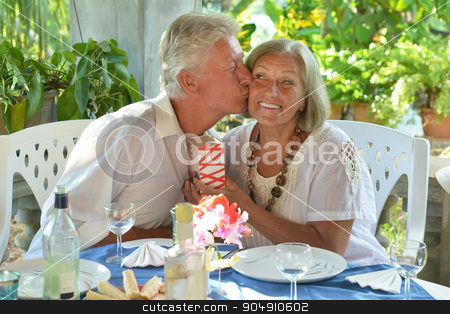 Mature couple at restaurant stock photo, Happy mature couple eating dinner at restaurant by Ruslan Huzau