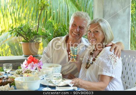Mature couple at restaurant stock photo, Happy mature couple eating dinner at restaurant by Ruslan Huzau
