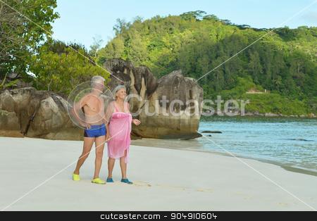 elderly couple rest at tropical resort stock photo, Beautiful happy elderly couple rest at tropical resort by Ruslan Huzau