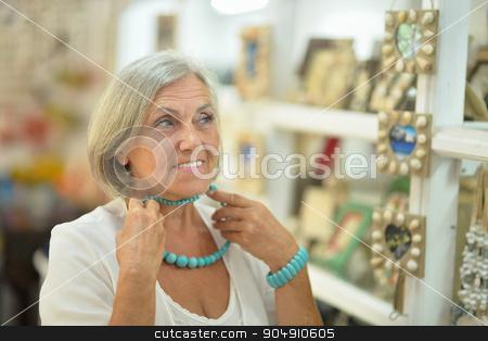woman in shopping center stock photo, Beautiful senior woman in a shopping center by Ruslan Huzau