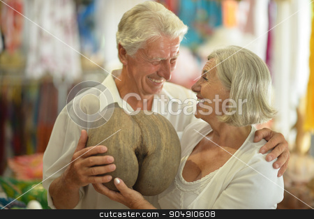 senior couple in a shopping center stock photo, Beautiful senior couple in a shopping center by Ruslan Huzau