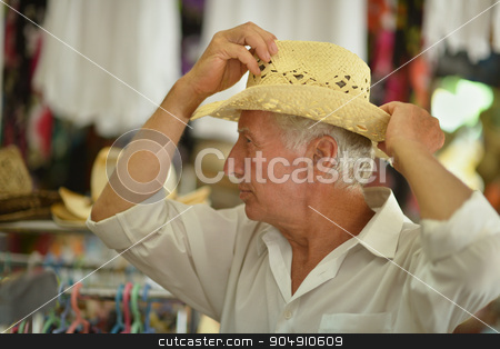 Mature man in hat stock photo, Portrait of a nice mature man in hat by Ruslan Huzau
